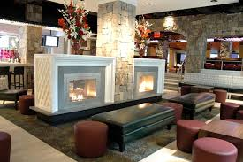 luxury interior design with duel see through fireplaces in bowlmor lanes by ny hearth