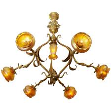 art nouveau chandelier with handblown shades for