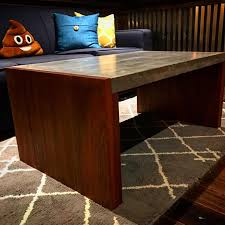 i made this coffee table recently it s a concrete top with sapele 2 1 2 thick legs finished with a satin oil finish