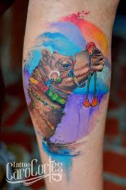 Watercolour Tattoo With Camel And Arm Tattoo