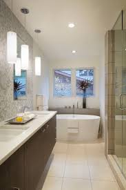 Modern Bathroom Interior With White Oval Bathtub And Shower Room Along With  Double Sinks And Stylish