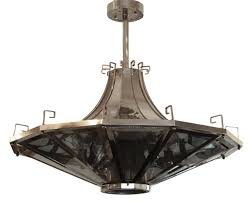 modern spaceship shaped light fixture with greek detailing on top french made in the 1950s