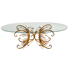 french style contemporary oval glass top coffee table with metal frame painted with gold color for modern minimalist living room spaces ideas