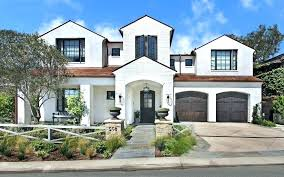 white house gray shutters brick painted exterior with two door garage wooden front light grey white house