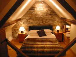 attic bedroom with cozy lighting ceiling and bed