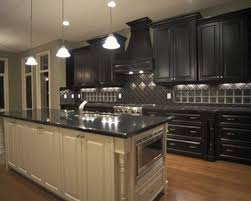 image of black kitchen cabinets with gold hardware