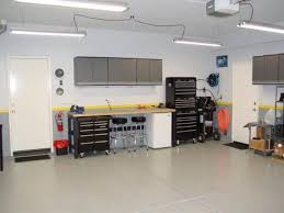 garage with cabinets and fluorescent lighting