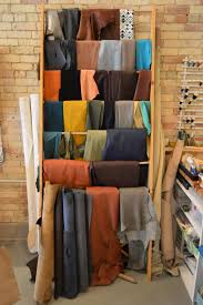 a rack holds some of the material used by the leather workers