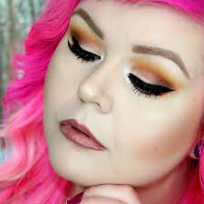 fire up your night with this warm toned eye makeup plimented with brown lips
