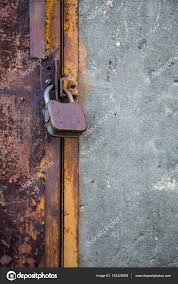 old rusty door with a lock stock photo