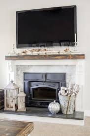 learn how to cover your brick fireplace to transform it from dated to modern farmhouse style