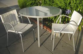 compact white patio chairs with round glass top table