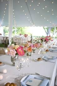 simple setting - long table, flowers, tea lights, fairy lights