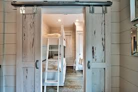 beach style kids room with small sliding barn doors design henderson development and