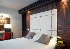 View in gallery Recessed lighting illuminates a hotel bed