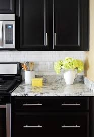 Black Granite Countertops With Tile Backsplash Best How To Install A Subway Tile Kitchen Backsplash Young House Love