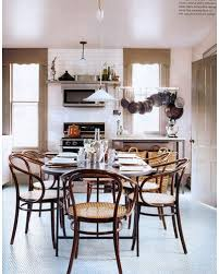 hanging dining room light over table. a single white pendant light over the table gives room lighter feel than chunky chandelier would. hanging dining n
