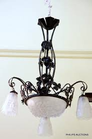 a fine art deco frosted glass and iron work chandelier by ros