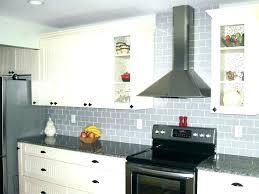 white kitchen cabinets with blue glass backsplash white glass kitchen image of modern glass subway tile kitchen designs white glass white glass white