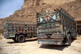 Collections | Regional Surveys | Peggy Crawford: Photographs of Yemen |  Near to Shabwah. General views. View of colorful ornamented trucks. |  Archnet