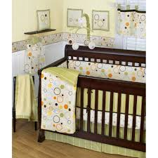 kids room colorful round pattern themes of baby nursery with dark brown wooden baby crib