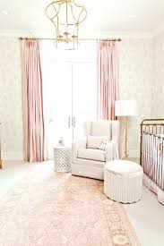 pink curtains gold chandelier white rocking chair and french inspired walls of nursery for baby room
