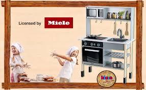 Klein 7199 Cuisine en bois Miele |Comprend une plaque de cuisson avec  effets sonores et lumineux | Dimensions : 70 cm x 30 cm x 91 cm |  Accessoires de grande qualité