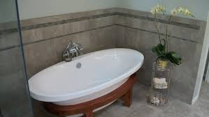 roman soaking tub.  Roman Free Standing Tub With Kohler Symbol Roman Filler And Handshower Tile  Continued From Shower Throughout Soaking Tub N