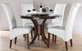 image of round white kitchen table and chairs
