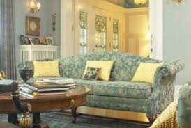 gold curtains living room. use blue and gold items throughout the room to reinforce color scheme. curtains living
