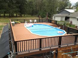 home swimming pools above ground. Above Ground Swimming Pool Deck Designs Home Pools T