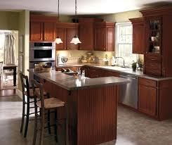 cherry cabinets kitchen dark cherry kitchen cabinets by cabinetry cherry kitchen cabinets with white quartz countertops