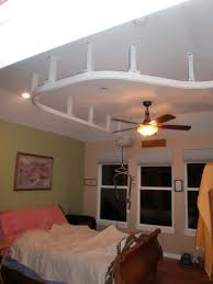 sagging tin ceiling tiles bathroom: suspended ceiling lift goes from bedroom to bathroom in lakewood bruno curved stair lift small bathroom remodel