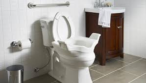 bathroom with grab bar over the toilet