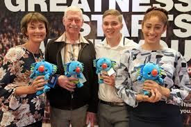 2018 bmw volunteers. modren 2018 two men and two women volunteers standing with commonwealth games mascot  toy boribi for 2018 bmw 2