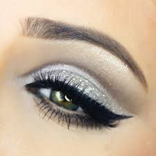 silver glitter eyes with dramatic winged liner