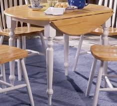 small round drop leaf dining table with white painted legs and 4 stunning tables spaces
