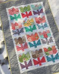 Lori Holt's Scrappy Project Planner | The Stitching Scientist & Patchwork Tulip Quilt on ground Adamdwight.com