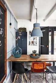 modern rustic dining room design with industrial farmhouse style featuring a palette of white um and dark gray and wood tones modern rustic home ideas