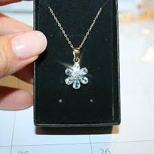 blue topaz diamond flower pendant