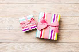 Beautiful Gift Box Design Beautiful Gift Box With A Colored Bow On The Orange Wooden Table