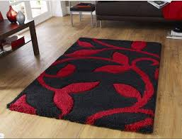 we love this modern black and red rug it s dark tones are a great contrast against wooden floors and white walls