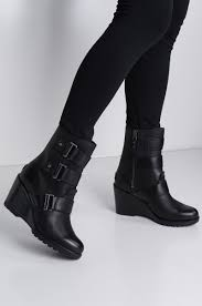 front view sorel after hours waterproof leather wedge bootie in black