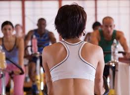 rear view of instructor in spinning cl indoor cycling can lead to weight loss