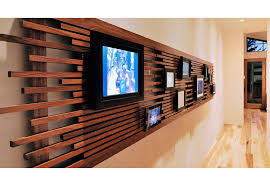 interior view of a hallway leading to the office and showcasing a custom digital photo display