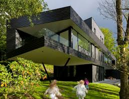 Dark Modern Home in Norway furthermore Three Storey Modern Villa in Waterfront Location – Villa Ypenburg likewise Modern home by MDT Homes  Kamloops BC with Charcoal Ledgestone likewise  also Modern house design front view with small garden and gray path likewise 1186 best Modern   Design images on Pinterest   Architecture  Live moreover  in addition  further Contemporary  Modern  Retro  Dark Room Photos in addition Modern Family Home in The  herlands  Tradition with a Twist in addition Best 25  Modern home offices ideas on Pinterest   Modern home. on dark modern home