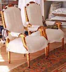 chair slipcovers with oned tabs straps to let the wood show pandora de balthazar