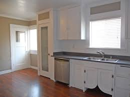 kitchen with newer dishwasher and gas stove glass door to pantry newer sink