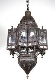 large moroccan moorish star shaped lantern with clear glass multifaceted and intricate filigree work on