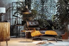 exotic living room furniture. Small, Dark Living Room With Vintage Furniture And Exotic Looking Plants Stock Photo - 84546611 R